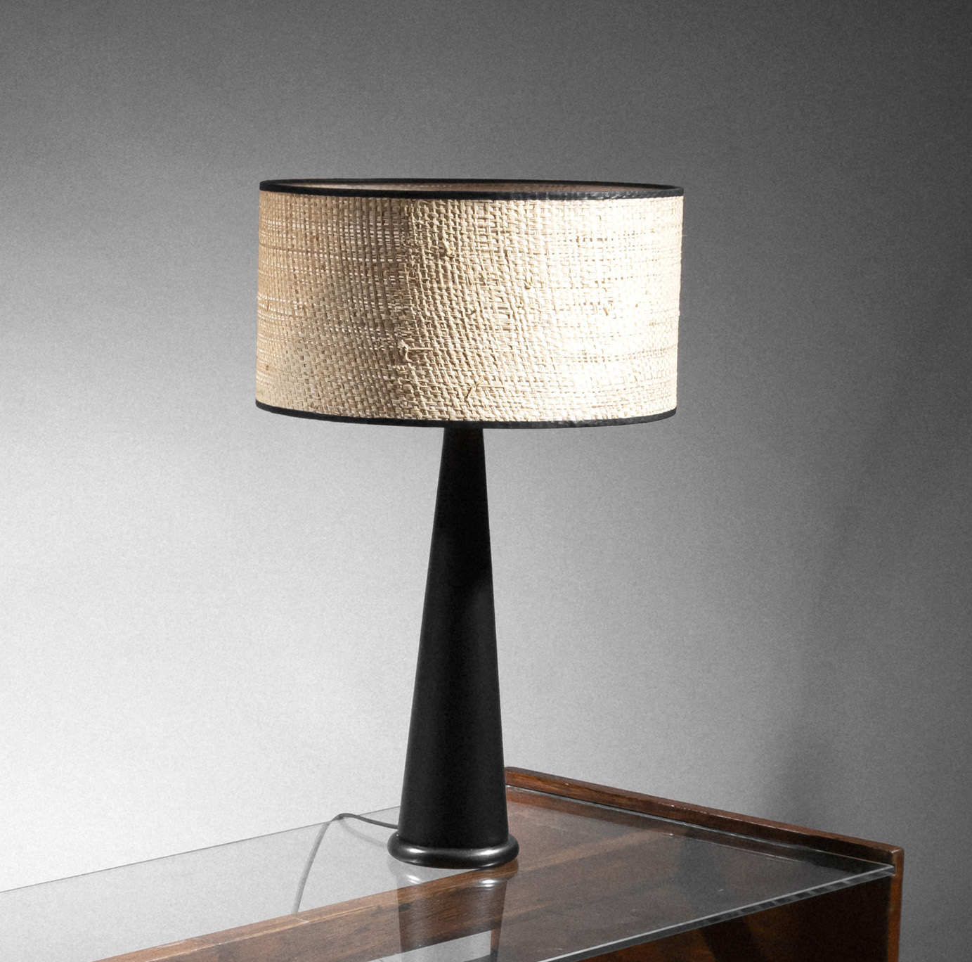 Result: €780 French, 20th century, table lamp, base in black imitation leather and steel with a black patina, braided rattan shade with bl