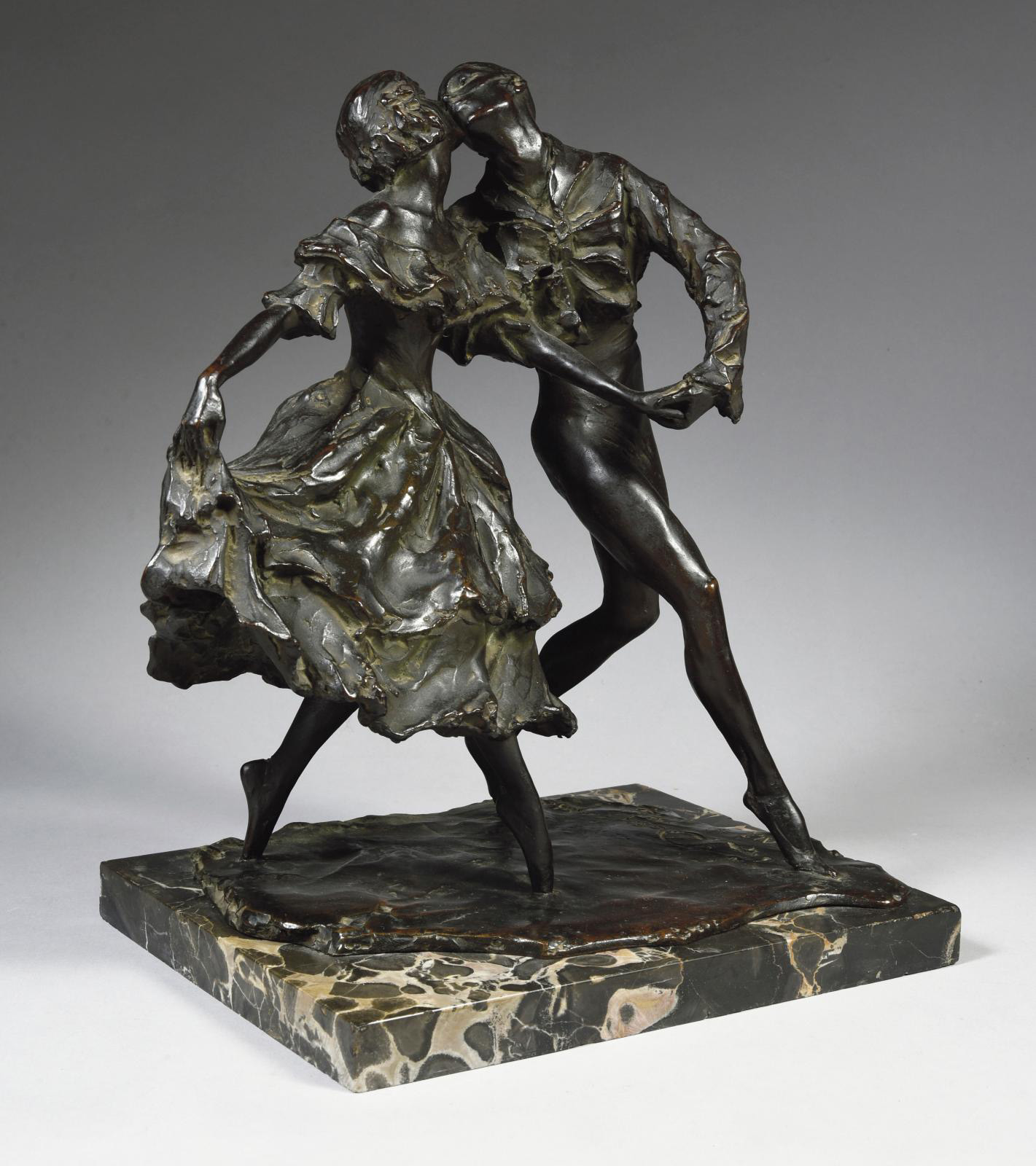 A bronze sculpture of a dancing couple is visible in a period photograph of Prince and Princess Yusupov's Paris home, which has none of th