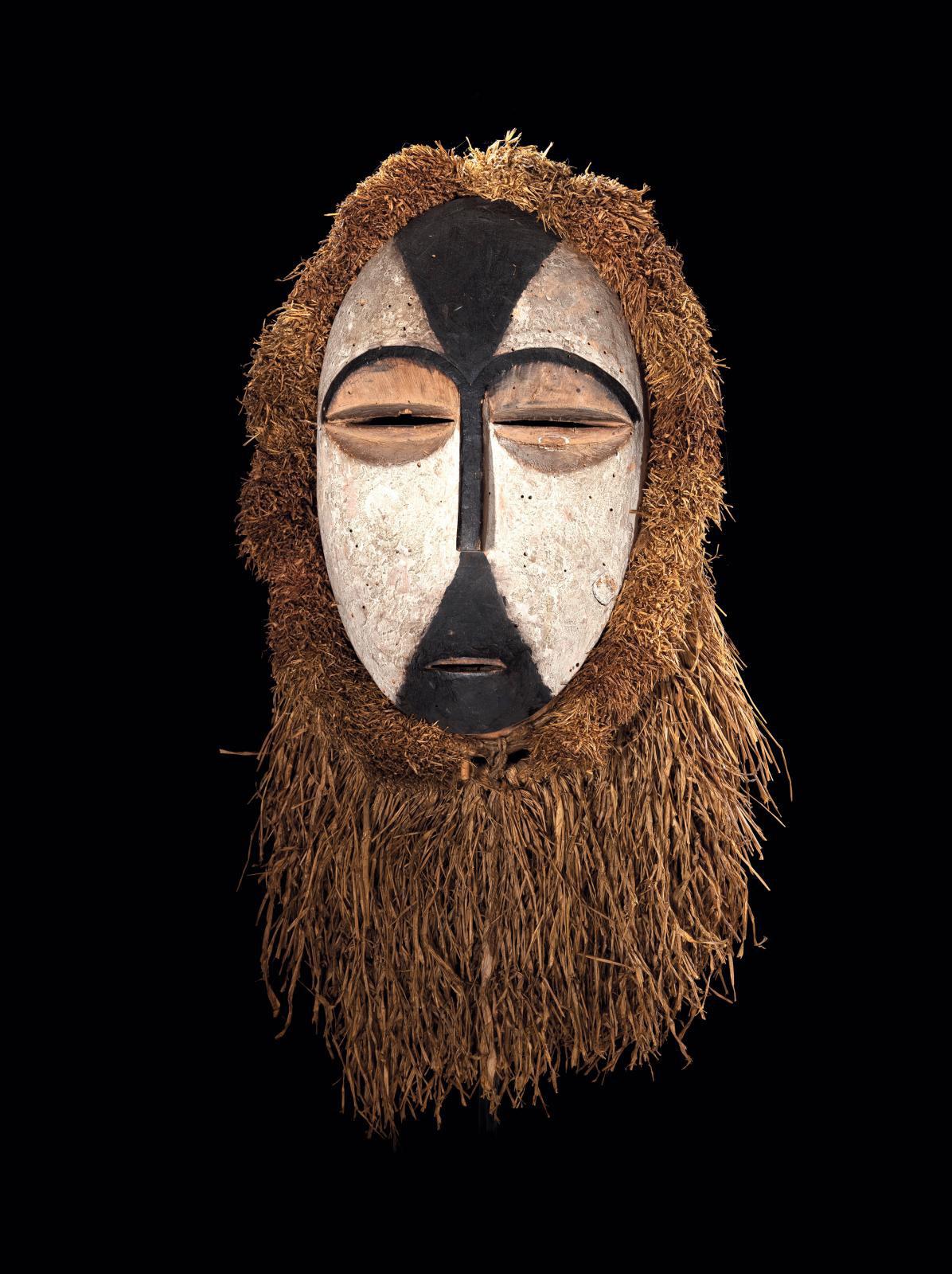 Gabon, 19th century, Galoa people, Okukwe mask, wood, black and white pigments, raffia, h. 27 cm/10.62 in. Galerie Patrik Fröhlich.Courtes