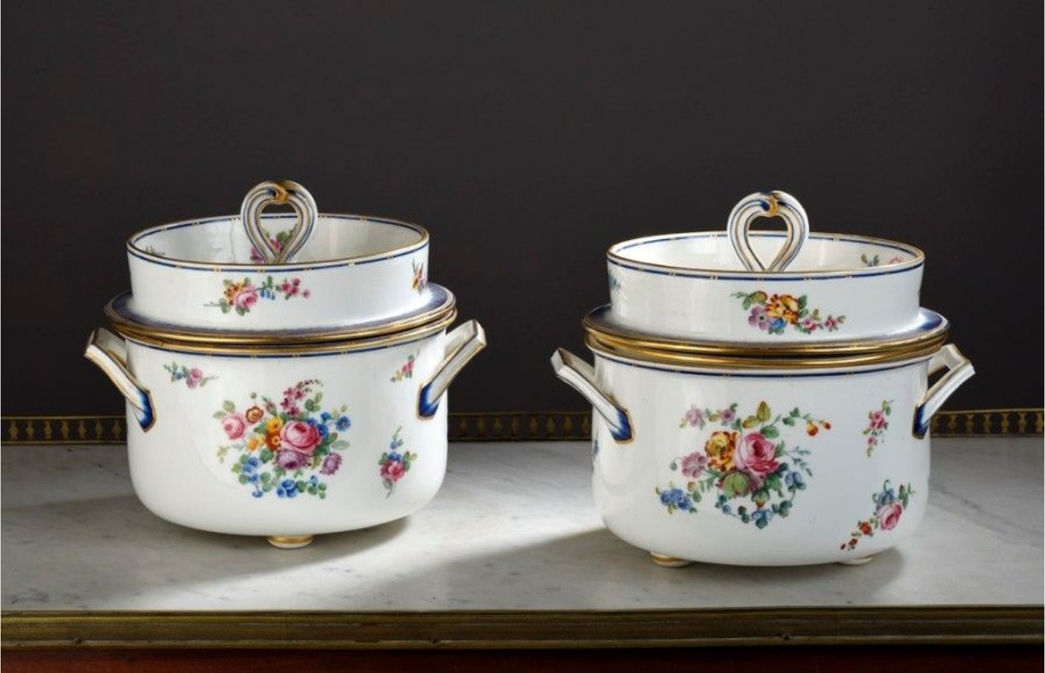 """€5,250Sèvres, two cylindrical soft-paste porcelain coolers with polychrome flower and blue """"peigné"""" decoration, 1772, h. 21 cm/8.3 in.Pari"""