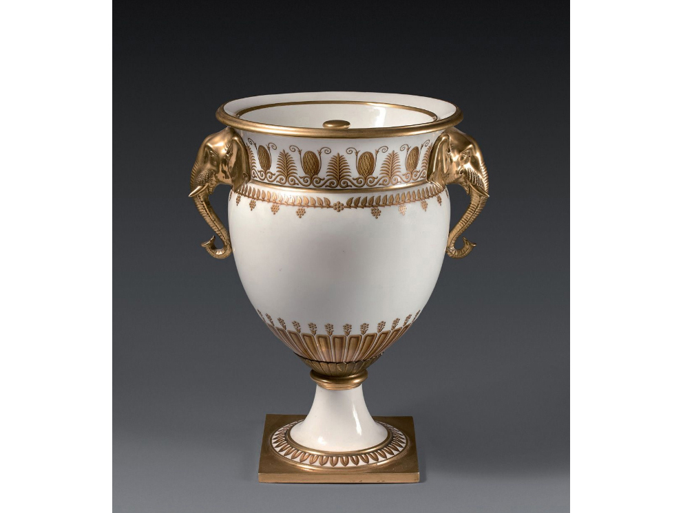 €5,750Sèvres, white porcelain elephant-head cooler, gold and brown decoration of palmettes and foliage, Louis XVIII period, h. 33 cm/13 in