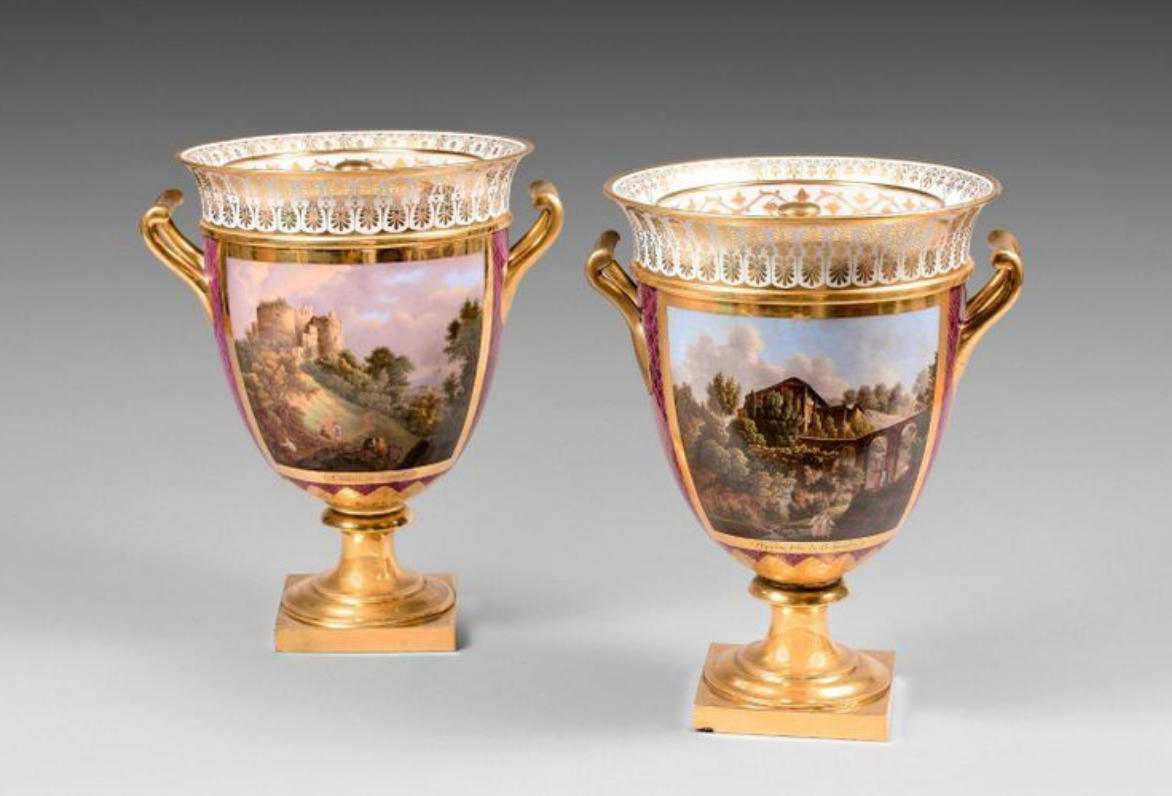 """€5,232Sèvres, pair of hard-paste porcelain lidded """"AB"""" vase coolers with purple background and polychrome decoration of landscapes in cart"""