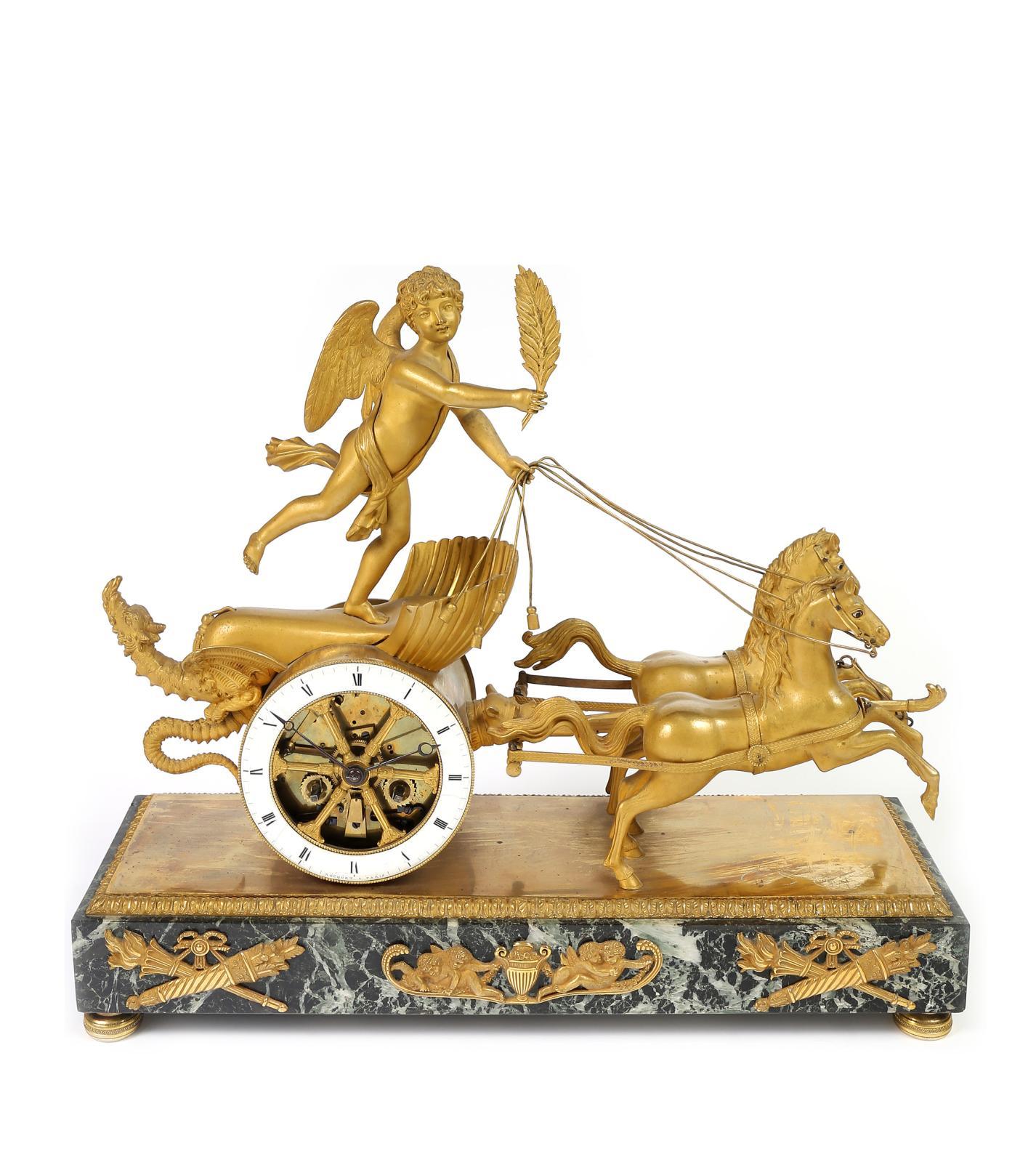 Pendule dite «au char de l'Amour», en bronze ciselé et doré, mouvement squelette inscrit dans la roue du char, type Breguet, cadran signé de Rocquet à