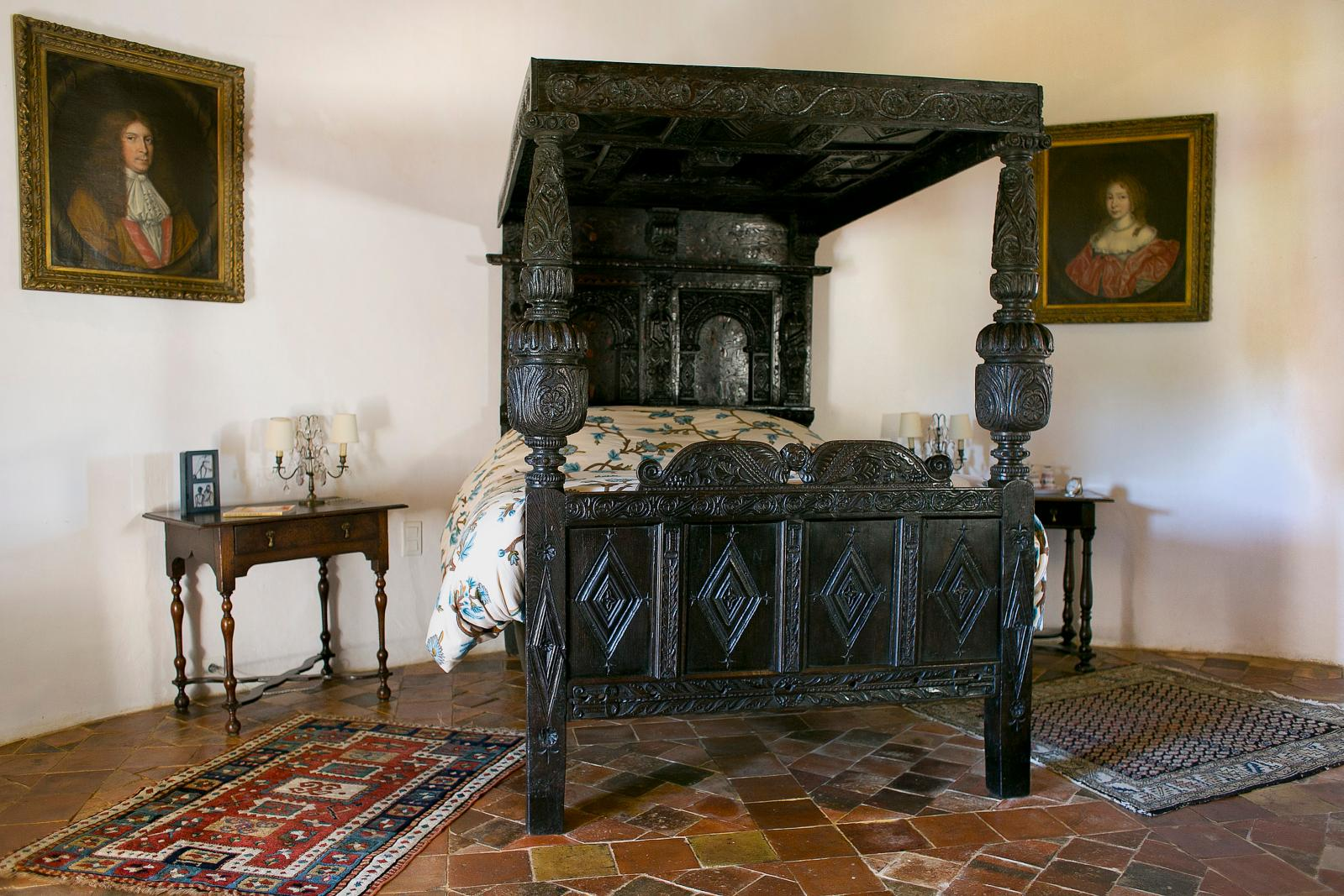English oak bed dating from 1633, with its central marquetry panel at Château Lagrézette, Alain-Dominique Perrin's estate.